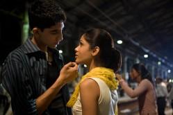 Dev Patel as Jamal Malik and Anil Kapoor as Prem Kumar from Slumdog Millionaire