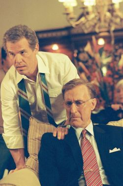 George W. Bush and George H. W. Bush (James Cromwell)