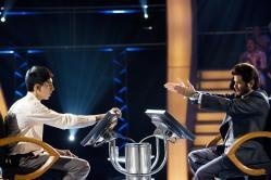Jamal (Dev Patel) and Prem Kumar (Anil Kapoor) from <em>Slumdog Millionaire</em>