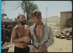 'Doc' Tydon (Donald Pleasence) and John Grant (Gary Bond)