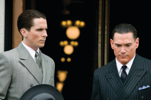 Special Agent Melvin Purvis (Christian Bale) and  J. Edgar Hoover (Billy Crudup)