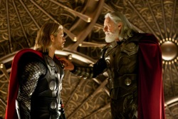 Thor (Chris Hemsworth) and Odin (Anthony Hopkins)