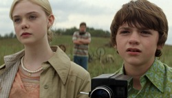 Super 8: Alice Dainard (Elle Fanning) and Joe Lamb (Joel Courtney)