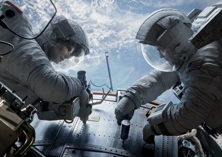 Gravity: Dr Ryan Stone (Sandra Bullock) and Matt Kowalski (George Clooney)