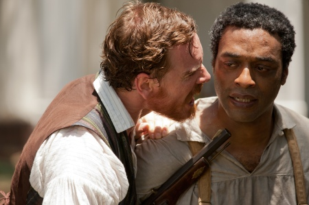 Michael Fassbender as Edwin Epps and Chiwetel Ejiofor as Solomon Northup in 12 Years a Slave